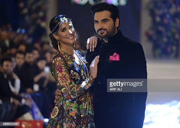 Models present creations by Pakistani designer Nomi Ansari on the final day of the Pakistan Fashion Design Council L'Oreal Paris Bridal Week in...