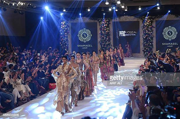 Models present creations by Pakistani designer Shamaeel Ansari on the final day of the Pakistan Fashion Design Council L'Oreal Paris Bridal Week in...