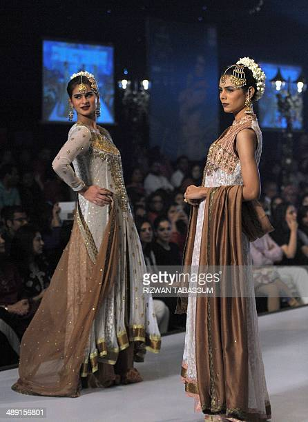 Models present creations by Pakistani designer Somal Halepoto during the second day of the Bridal couture week in Karachi on May 10 2014 AFP PHOTO/...