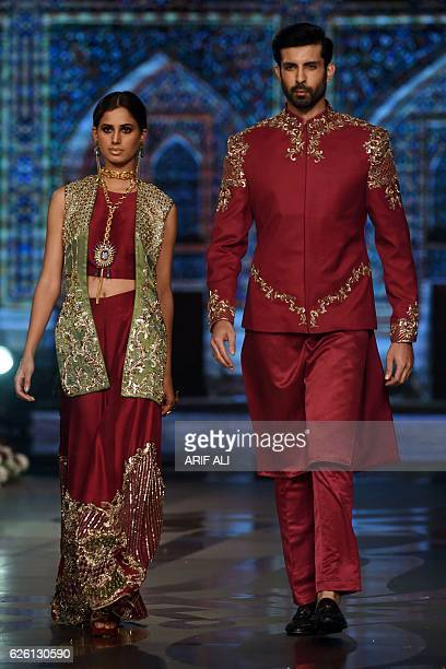 Models present creations by Pakistani fashion designer Faiza Saqlain on the final day of the Fashion Bridal Couture Week in Lahore on November 27...
