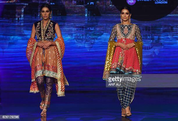 Models present creations by Pakistani fashion designer Wardha Saleem on the final day of the Fashion Bridal Couture Week in Lahore on November 27...