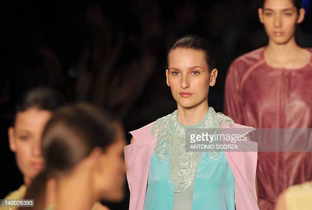 Models present creations by Patachou at the Fashion Rio Summer 2012 show in Rio de Janeiro Brazil on May 22 2012 AFP PHOTO/ANTONIO SCORZA