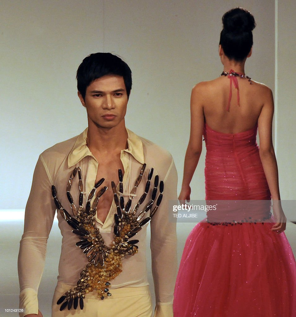Models present creations by Philippine designer John Guarnes during the Philippine Fashion week in Manila on May 28, 2010. The Philippine fashion show is being held from May 27 to June 1, 2010.