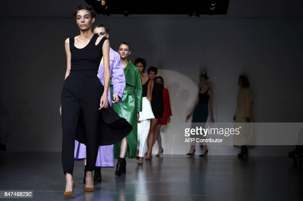 Models present creations by Polish born designer Marta Jakubowski during a catwalk show for her Spring/Summer 2018 collection on the first day of...