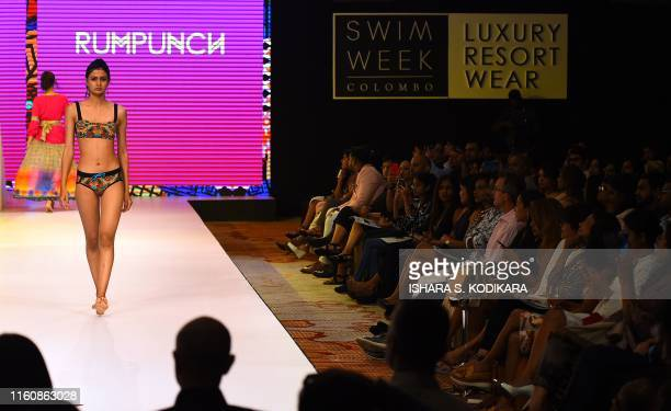 Models present creations by Rumpunch during Swim Week Colombo a fashion week dedicated to swimwear and resort wear in Colombo on August 10 2019