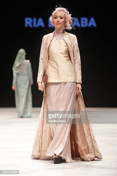 Models present creations by Rya Baraba during the Indonesia Fashion Week Indonesia Fashion Week theme is Reflections of Culture as local culture and...