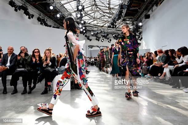 Models present creations by Sacai at the end of the Spring-Summer 2019 Ready-to-Wear collection fashion show in Paris, on October 1, 2018.