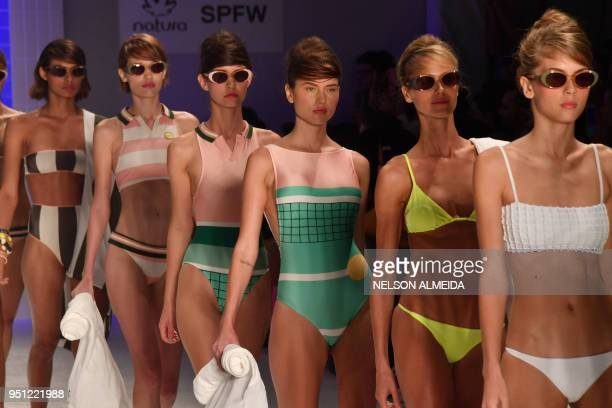 Models present creations by Salinas during the Sao Paulo Fashion Week in Sao Paulo Brazil on April 25 2018