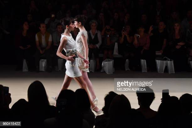 TOPSHOT Models present creations by Samuel Cirnansck during the Sao Paulo Fashion Week in Sao Paulo Brazil on April 23 2018