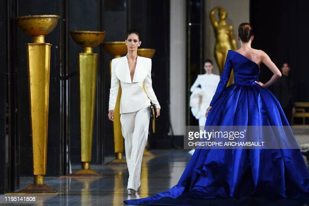 Models present creations by Stephane Rolland during the Women's Spring-Summer 2020/2021 Haute Couture collection fashion show in Paris, on January...