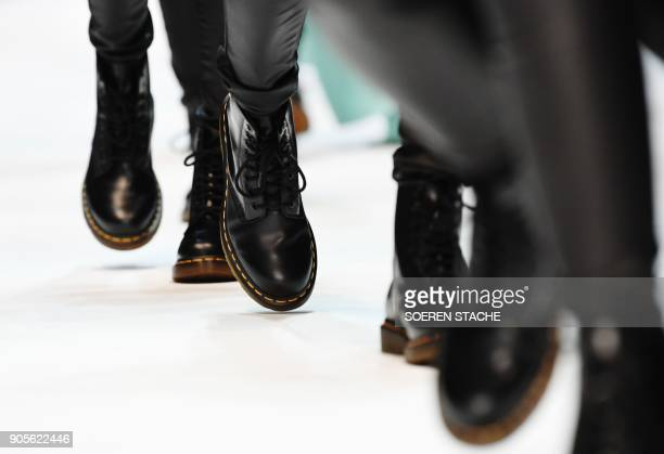 Models present creations by the Italian label 'Cashmere Victim' during the Berlin Fashion Week in Berlin on January 16 2018 PHOTO / dpa / Soeren...