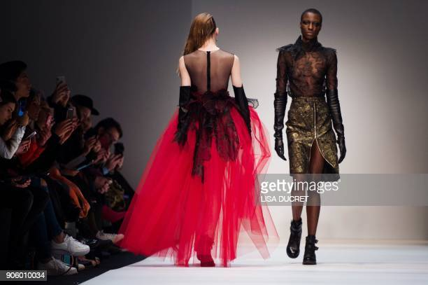 Models present creations by the label 'Irene Luft' during the Fashion Week in Berlin on January 17 2018 / AFP PHOTO / dpa / Lisa Ducret / Germany OUT