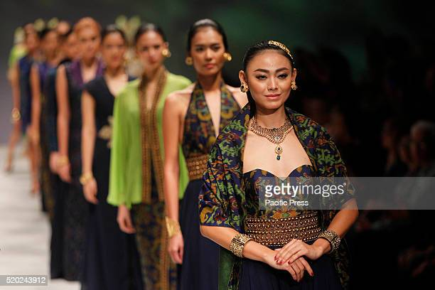 Models present creations by Tjok Abi during the Indonesia Fashion Week Indonesia Fashion Week theme is Reflections of Culture as local culture and...