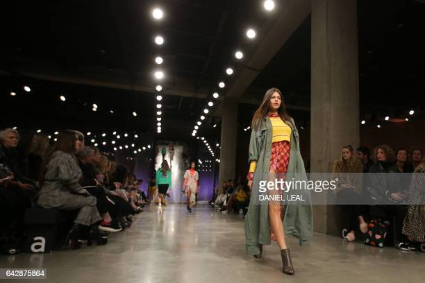 Models present creations by TOPSHOP UNIQUE during a catwalk show on the third day of the Autumn/Winter 2017 London Fashion Week in London on February...