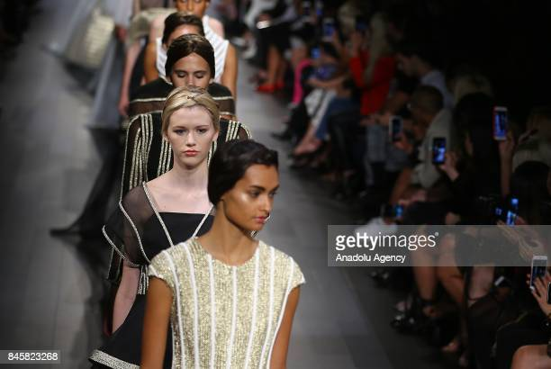 Models present creations by Turkish fashion designer Numan Ataker during New York Fashion Week on September 11 in New York United States