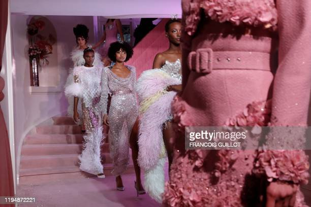 Models present creations by Ulyana Sergeenko during the rehearsal of the Women's Spring-Summer 2020/2021 Haute Couture collection fashion show in...
