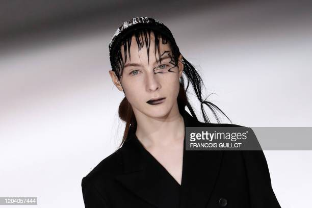 Models present creations by Yohji Yamamoto during the Women's Fall-Winter 2020-2021 Ready-to-Wear collection fashion show in Paris, on February 28,...