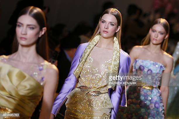 Models present creations by Zuhair Murad during the Haute Couture SpringSummer 2014 collection show on January 23 2014 in Paris AFP PHOTO / PATRICK...
