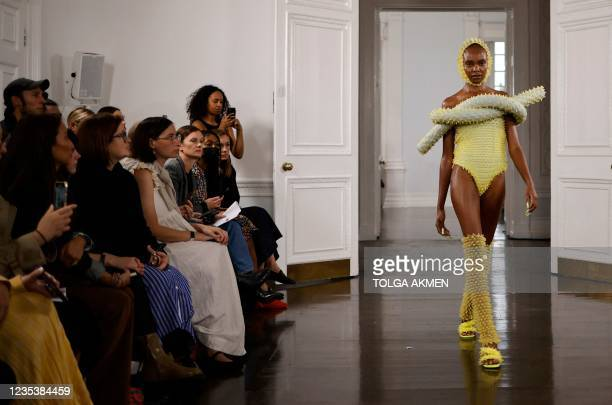 Models present creations during a catwalk show for Fashion East during the Spring/Summer 2022 collection show on the fourth day of London Fashion...