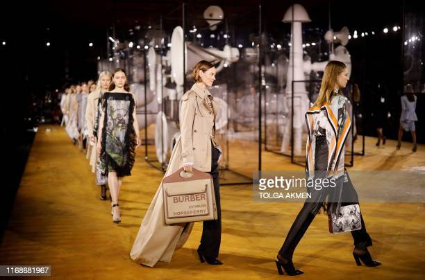 TOPSHOT Models present creations during a catwalk show for the Burberry Spring/Summer 2020 collection on the fourth day of London Fashion Week in...