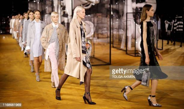 Models present creations during a catwalk show for the Burberry Spring/Summer 2020 collection on the fourth day of London Fashion Week in London on...