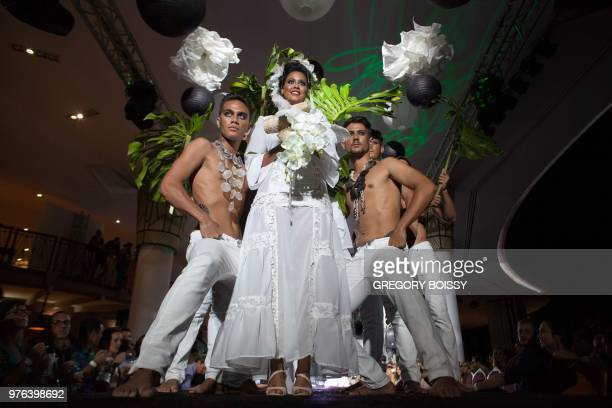 Models present creations during a models contest on the last day of the Tahiti Fashion Week on June 15, 2018 in Papeete.