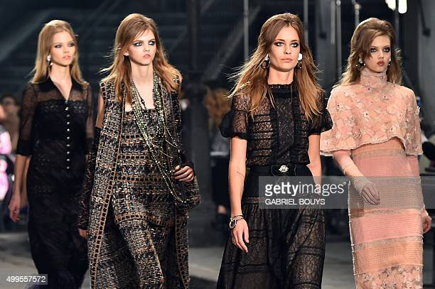 Models present creations during the 12th Chanel Metiers dArt show ParisRome an annual event to honor craftsmanship that artisan partners bring to the...