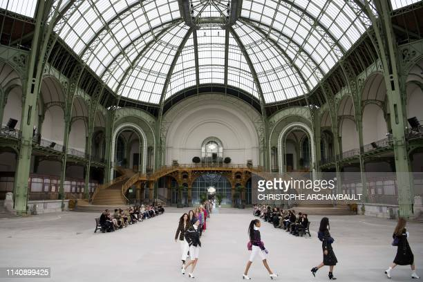 Models present creations during the 2020 Chanel Croisiere fashion show at the Grand Palais in Paris on May 3, 2019.
