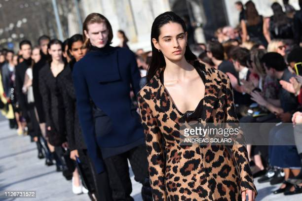 Models present creations during the Bottega Veneta women's Fall/Winter 2019/2020 collection fashion show on February 22 2019 in Milan