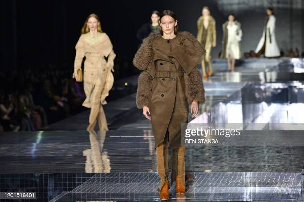 Models present creations during the British fashion house Burberry 2020 Autumn / Winter collection catwalk show during London Fashion Week in London...