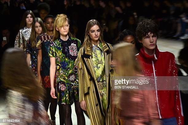 Models present creations during the Burberry Prorsum catwalk show at the Autumn / Winter 2016 London Fashion Week in London on February 22 2016 / AFP...