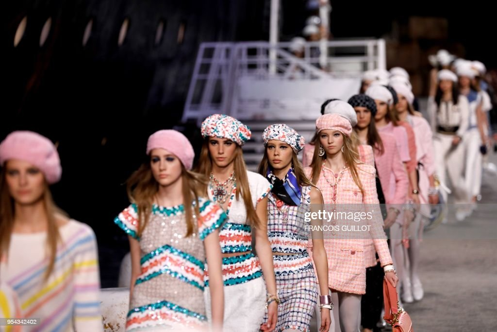 Models present creations during the Chanel Croisiere (Cruise) fashion show on May 3, 2018 at the Grand Palais in Paris.