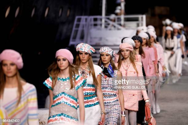 Models present creations during the Chanel Croisiere fashion show on May 3 2018 at the Grand Palais in Paris