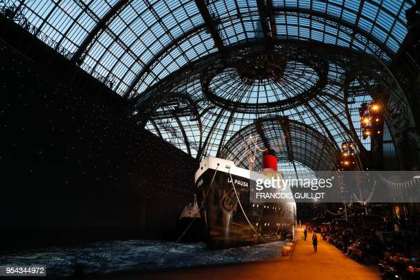 TOPSHOT Models present creations during the Chanel Croisiere fashion show on May 3 2018 at the Grand Palais in Paris