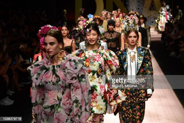 Models present creations during the Dolce Gabbana fashion show as part of the Women's Spring/Summer 2019 fashion week in Milan on September 23 2018