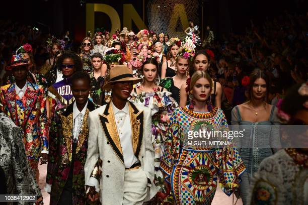 TOPSHOT Models present creations during the Dolce Gabbana fashion show as part of the Women's Spring/Summer 2019 fashion week in Milan on September...