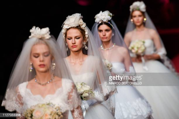 Models present creations during the Dolce & Gabbana women's Fall/Winter 2019/2020 collection fashion show, on February 24, 2019 in Milan.