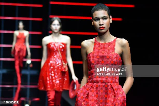 Models present creations during the Emporio Armani women's Fall/Winter 2019/2020 collection fashion show, on February 21, 2019 in Milan.