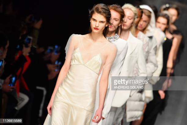 Models present creations during the Ermanno Scervino women's Fall/Winter 2019/2020 collection fashion show on February 23 2019 in Milan