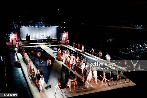 TOPSHOT Models present creations during the Etam Live Show on the first day of the Paris Fashion Week at the Roland Garros stadium in Paris on...