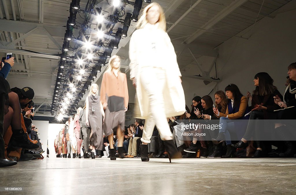 Models present creations during the Jeremy Laing fall 2013 fashion show during Mercedes-Benz Fashion Week at Pier 59 on February 10, 2013 in New York City.