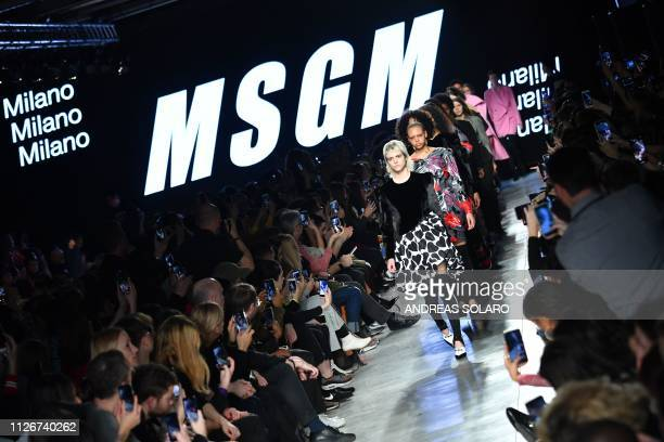 Models present creations during the MSGM women's Fall/Winter 2019/2020 collection fashion show, on February 22, 2019 in Milan.