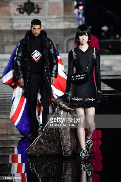 Models present creations during the presentation of French fashion editor Carine Roitfeld's CR Runway concept with Italian luxury retailer...