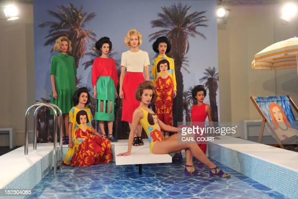 Models present creations during the Tata Naka 2013 spring/summer collection presentation at London Fashion Week in London on September 18, 2012. AFP...