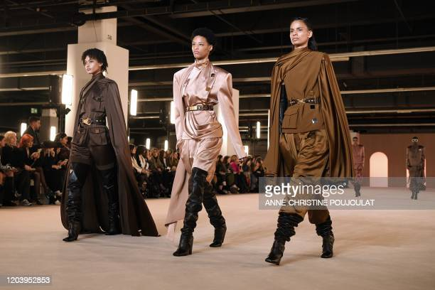 Models present creations for Balmain during the Women's Fall-Winter 2020-2021 Ready-to-Wear collection fashion show in Paris, on February 28, 2020.