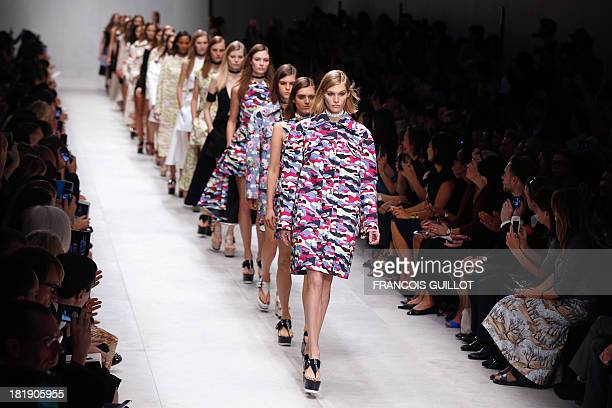 Models present creations for Carven during the 2014 Spring/Summer readytowear collection fashion show on September 26 2013 in Paris AFP PHOTO /...