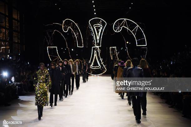 Models present creations for Celine at the end of the Women's Fall-Winter 2020-2021 Ready-to-Wear collection fashion show in Paris, on February 28,...