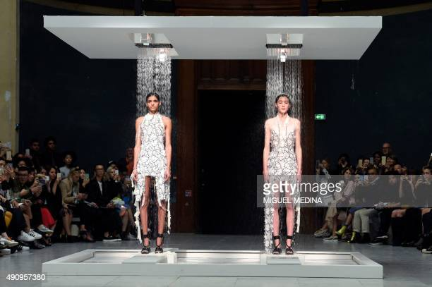 Models present creations for Chalayan during the 2016 Spring/Summer readytowear collection fashion show on October 2 2015 in Paris AFP PHOTO / MIGUEL...