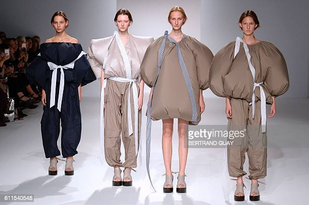 TOPSHOT Models present creations for Chalayan during the 2017 Spring/Summer readytowear collection fashion show on September 30 2016 in Paris / AFP /...