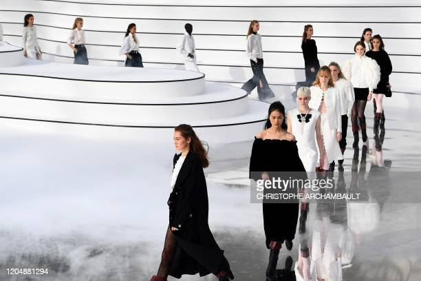 Models present creations for Chanel at the end of the Women's Fall-Winter 2020-2021 Ready-to-Wear collection fashion show in Paris, on March 3, 2020.